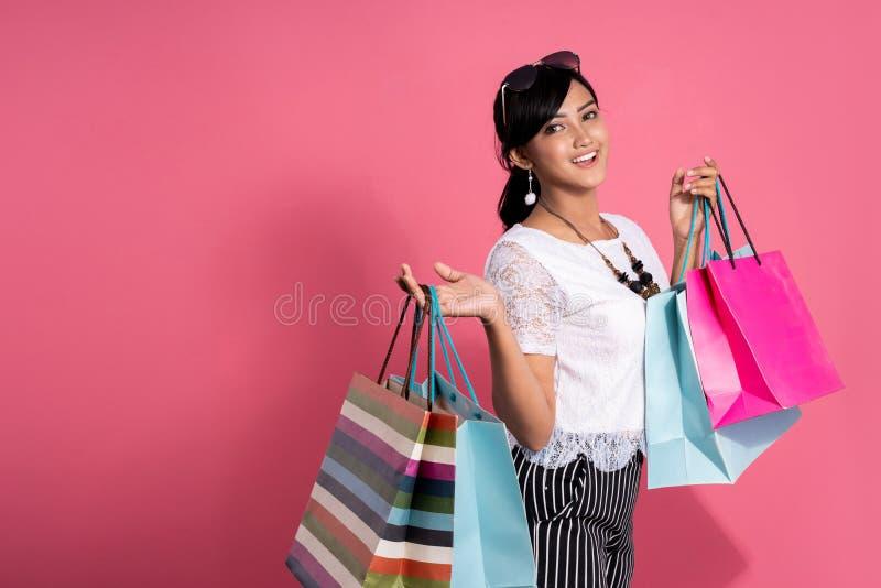 Asian beautiful woman with shopping bags stock photos