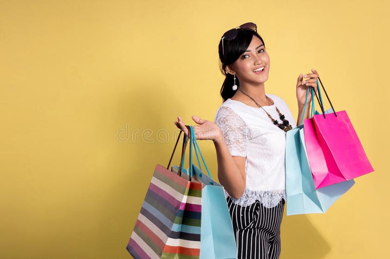 Asian beautiful woman with shopping bags stock photography