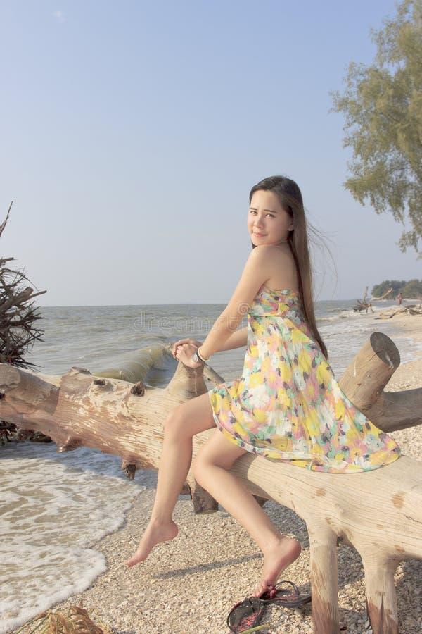 Beautiful asian woman at the beach stock photos