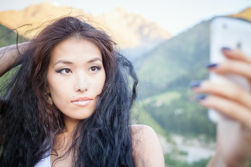 Beautiful asian woman smiling at mountain landscape stock image
