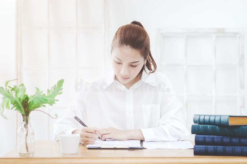 Woman working in the room. stock image