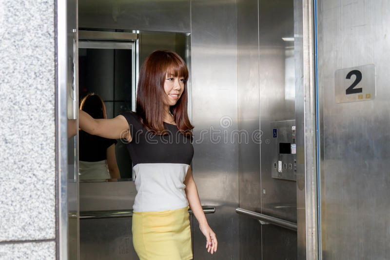 Beautiful Asian Woman Standing by Elevator royalty free stock images