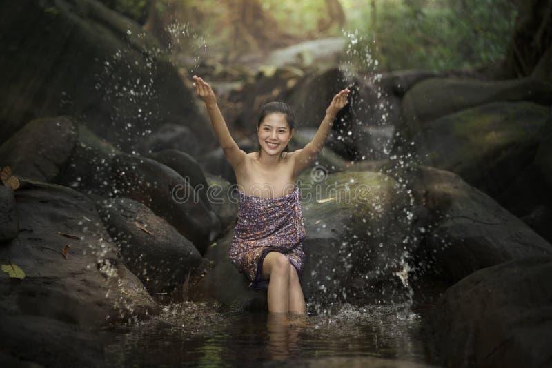 Beautiful asian woman take a bath in river royalty free stock photo