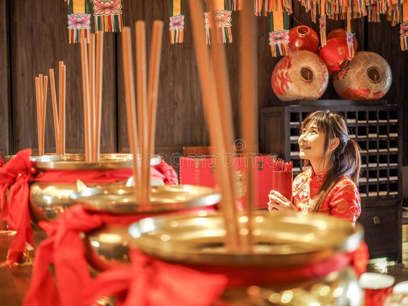 Beautiful Asian Woman with tradition clothing holding bamboo cylinder of Chi Chi Sticks or Chien Tung, Seam-Si, Chinese New Year stock images