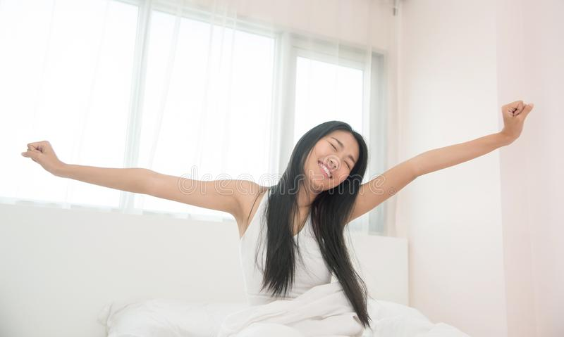 Beautiful Asian woman waking up in the morning. royalty free stock photo