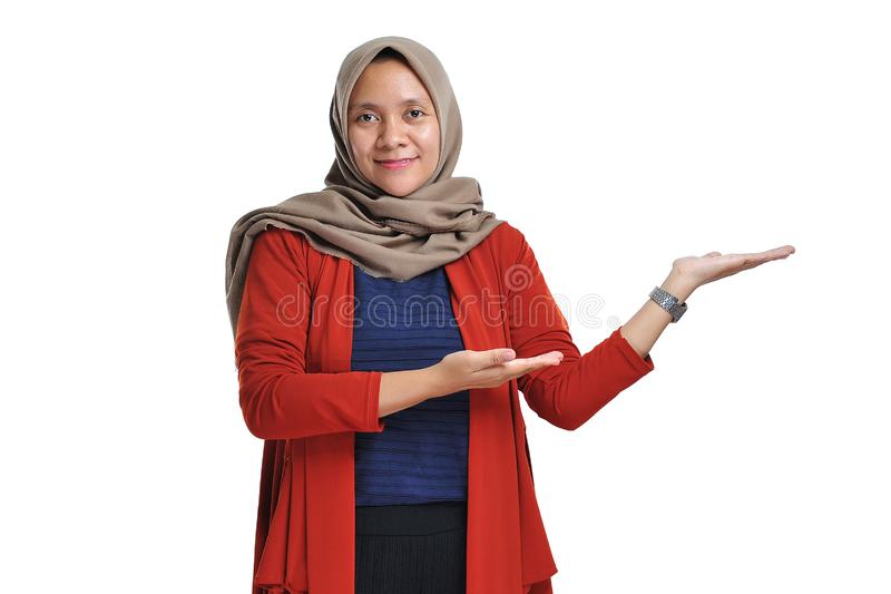 Beautiful Asian woman wearing hijab presenting blank area copy space stock images
