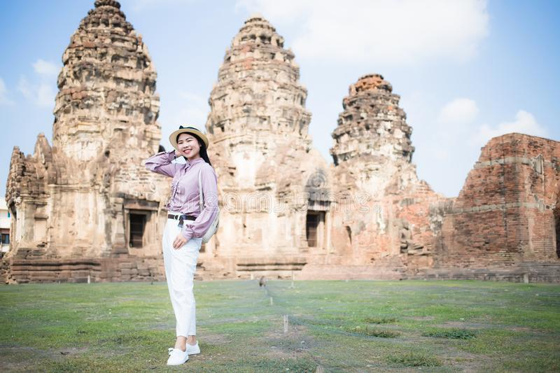 Beautiful Asian women, beautiful Thai people, casual wear, and wearing a hat standing in front of Phra Prang Sam Yot, Lop Buri royalty free stock images