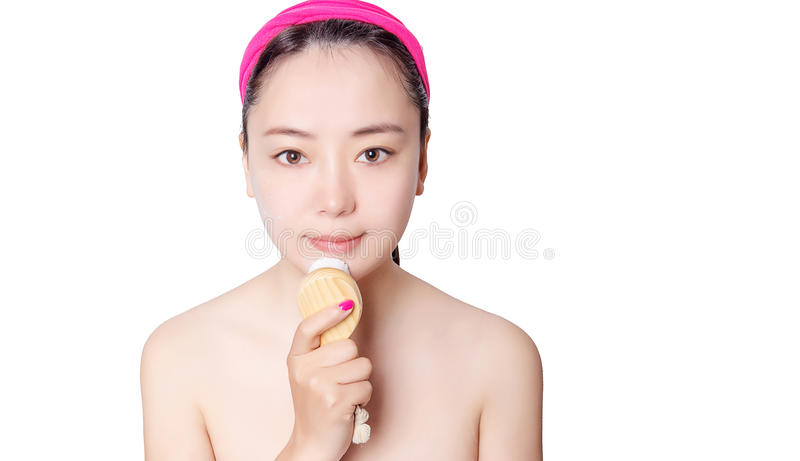 Beautiful Asian women in front of a single background skin care royalty free stock images