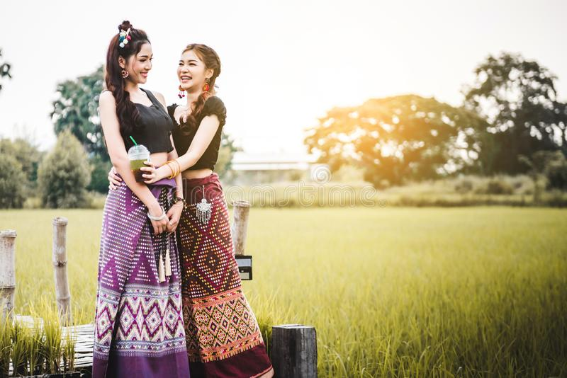 Beautiful Asian women in local dress standing and enjoy natural together on bamboo bridge stock photography