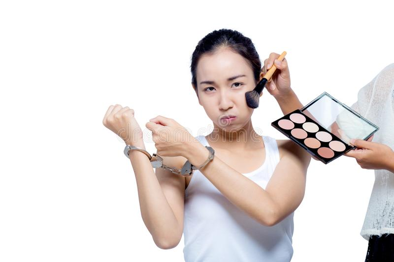 Beautiful Asian women with pure face and her hand in shackle. stock photos