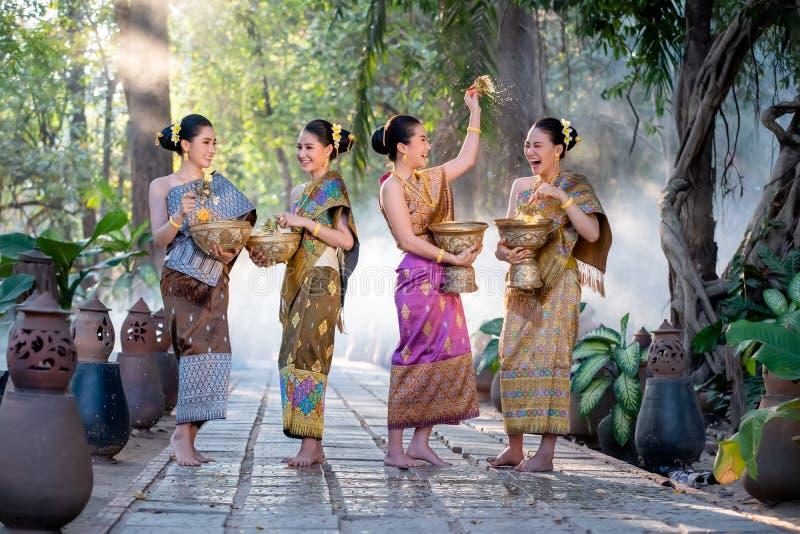 Beautiful Asian woman splashing water during tradition festival Thai. Beautiful Asian women splashing water during tradition festival Thai,Songkran festival stock photography
