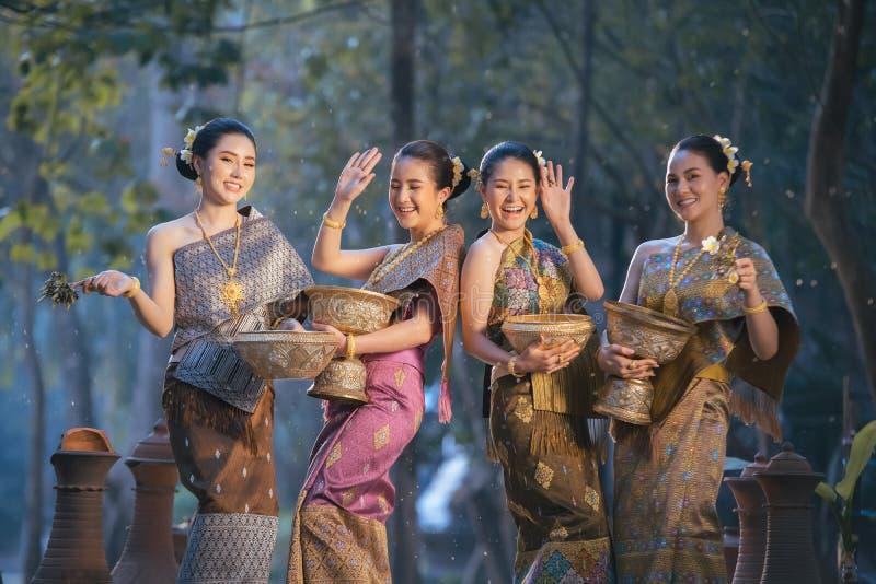 Beautiful Asian woman splashing water during tradition festival Thai. Beautiful Asian women splashing water during tradition festival Thai,Songkran festival stock image