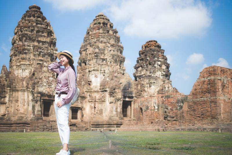 Beautiful Asian women, beautiful Thai people, casual wear, and wearing a hat standing in front of Phra Prang Sam Yot, Lop Buri stock photography