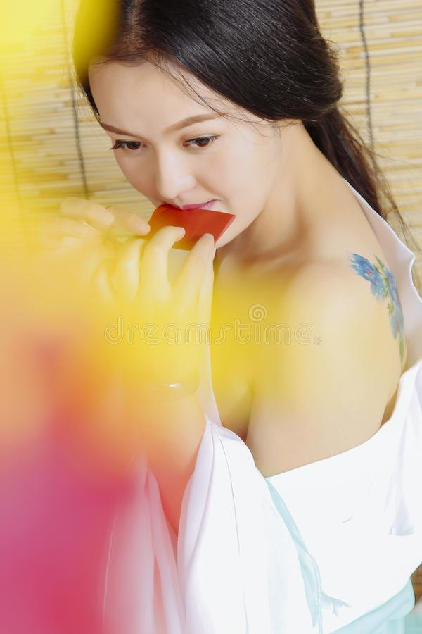 Beautiful Asian women are very sexy in ancient clothes. When shooting, the model should change into ancient clothes, dress up with retro makeup and modeling, and royalty free stock photos