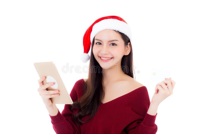 Beautiful asian young woman shopping with credit card and holding tablet in christmas holiday, girl with payment isolated on white stock photos