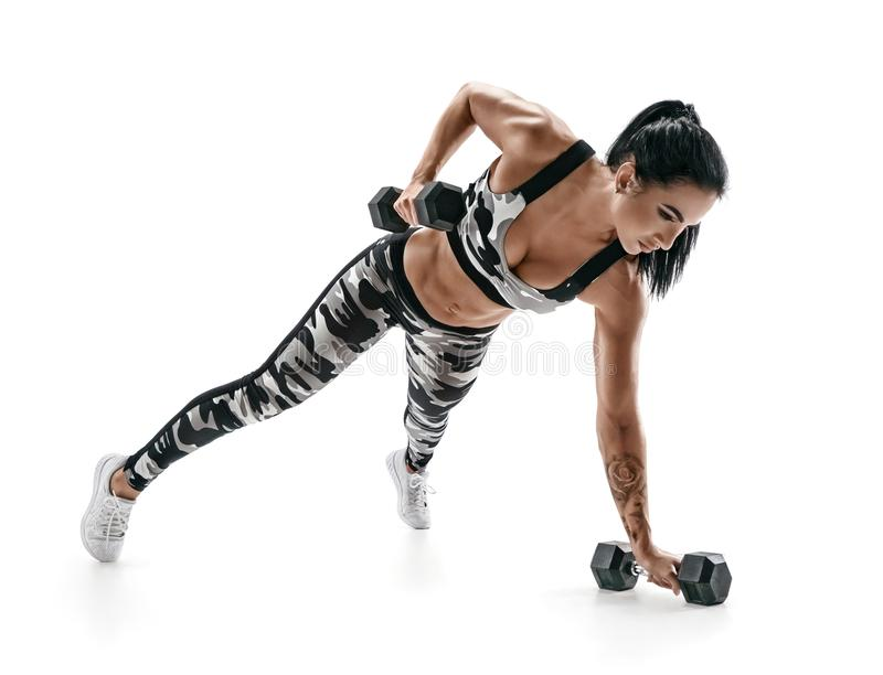 Beautiful athletic woman doing exercise with dumbbells stock photography