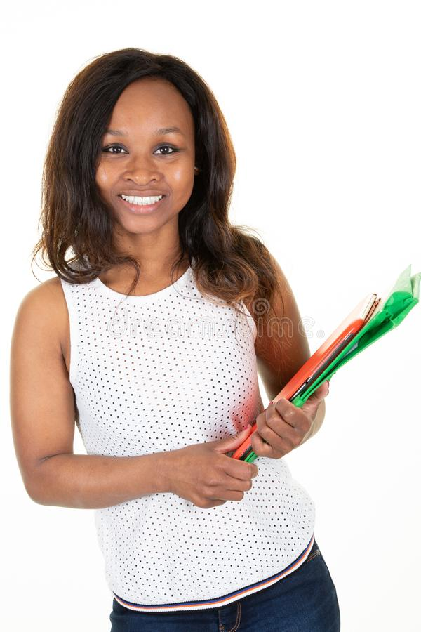 Beautiful attractive African American woman student girl with happy smiling in white studio background royalty free stock photography