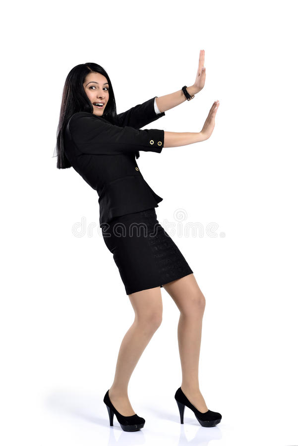 Beautiful attractive business women pushing royalty free stock photography