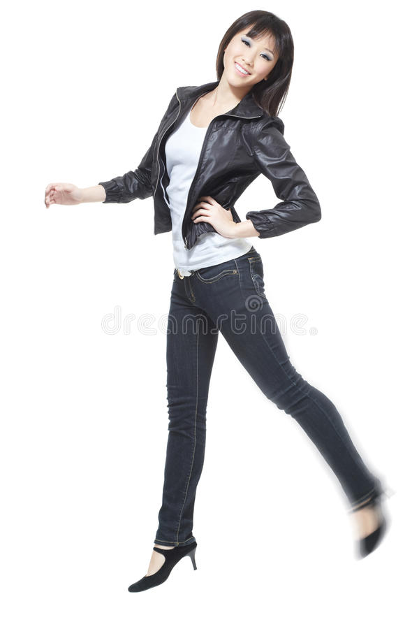 Beautiful, attractive chinese girl jumping in joy stock photo
