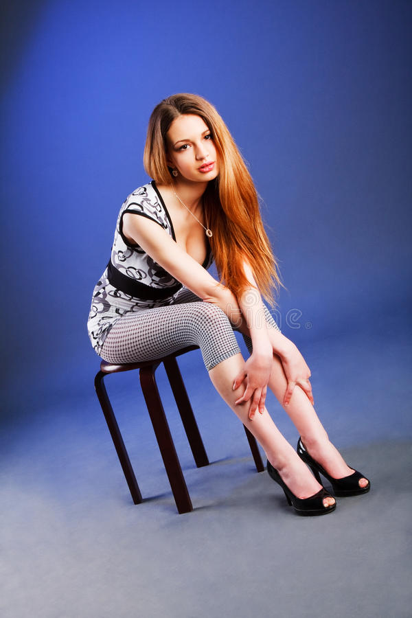 Beautiful attractive girl in blouse royalty free stock photography