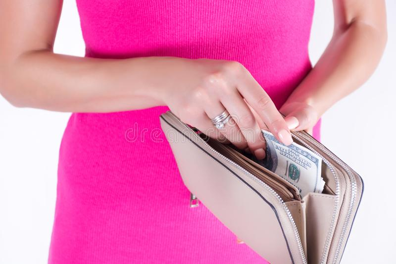 Woman hands taking out money America dollars banknotes form big wallet royalty free stock photo