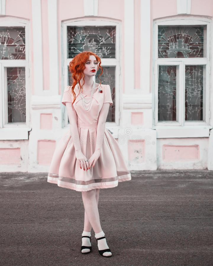 Beautiful attractive girl with red hair royalty free stock image