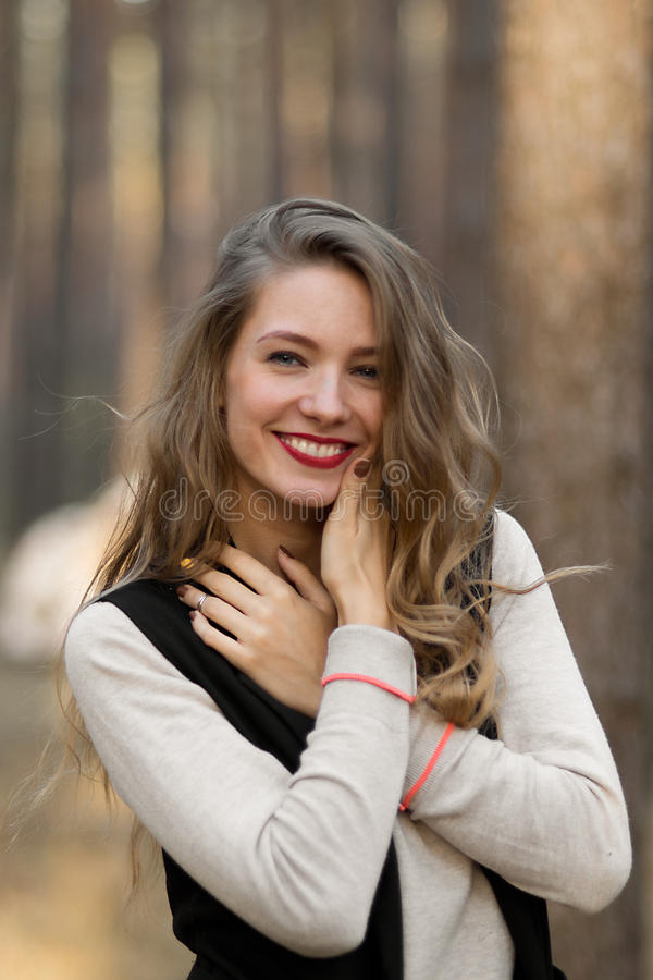 The happiest attractive girl with perfect nice healthy white smile and red lips, long hair laugh at something royalty free stock photography