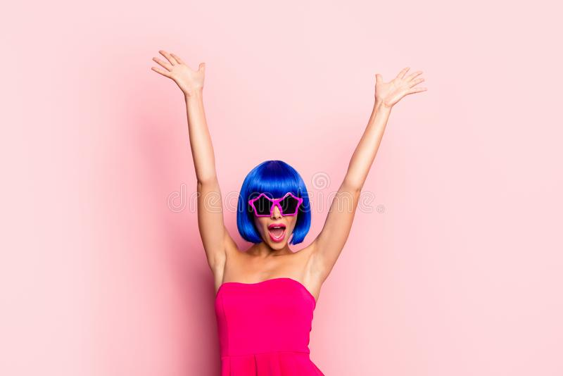 Beautiful, attractive, pretty, dreamy woman in dress with modern. Bright hairdo, expressive face, raise hands up and screaming loud celebrate forever twenty one stock photography