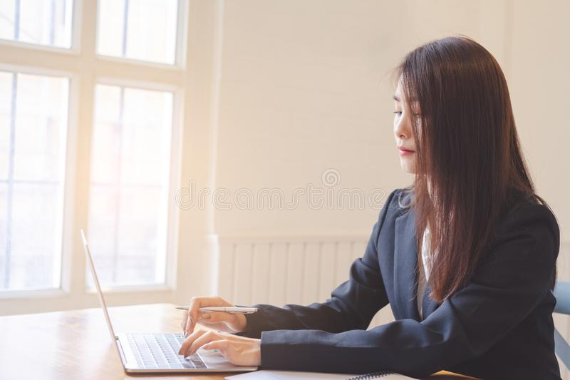 Beautiful attractive young asian business woman stock photo