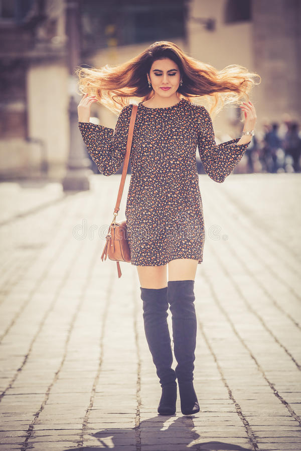 Beautiful and attractive young woman walking in the city royalty free stock photo