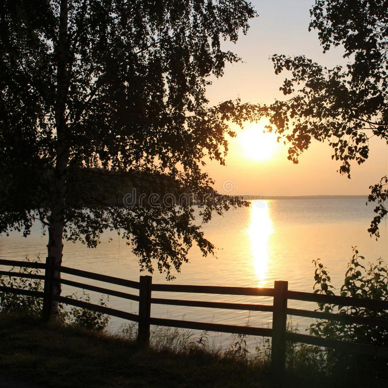 Beautiful August evening in Luleå. The sun is reflected in the bay on a beautiful August evening in the Northern Port of Lule royalty free stock images