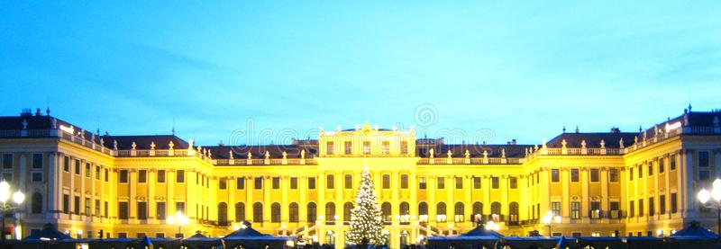 Beautiful austrian christmas market in vienna next to the castle at the blue hour. Beautiful austrian christmas market in vienna next to the Schonbrunn castle in royalty free stock photo