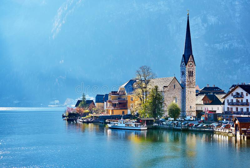 Beautiful autum landscape of Hallstatt mountain village with Hallstatter lake and boat in Austrian Alps. Austria, Salzkammergut region royalty free stock photography