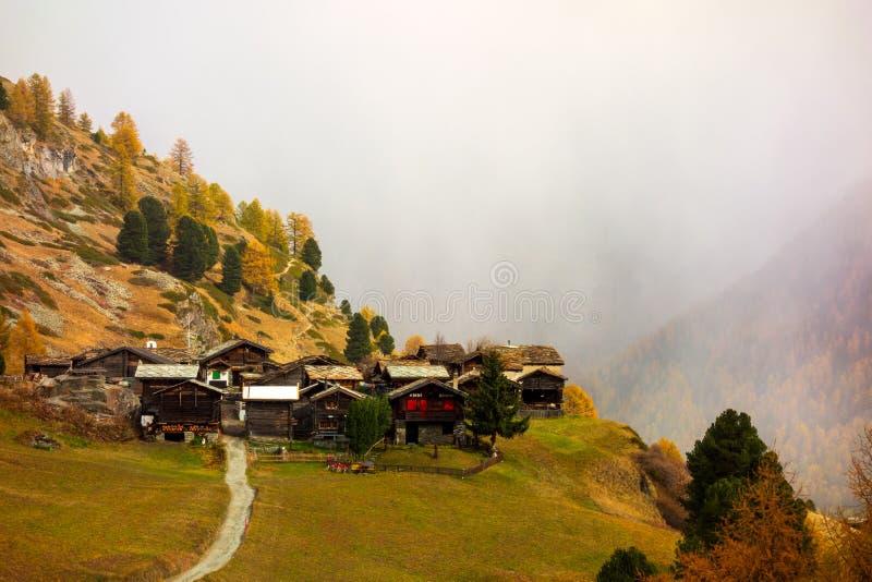 Beautiful autumn alpine landscape with many old chalets in Zermatt area. Beautiful autumn alpine landscape in Swiss Alps, with many old chalets in Zermatt area royalty free stock photos