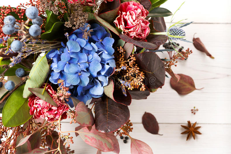 Beautiful autumn bouquet composition of dried meadow flowers and leaves royalty free stock photography
