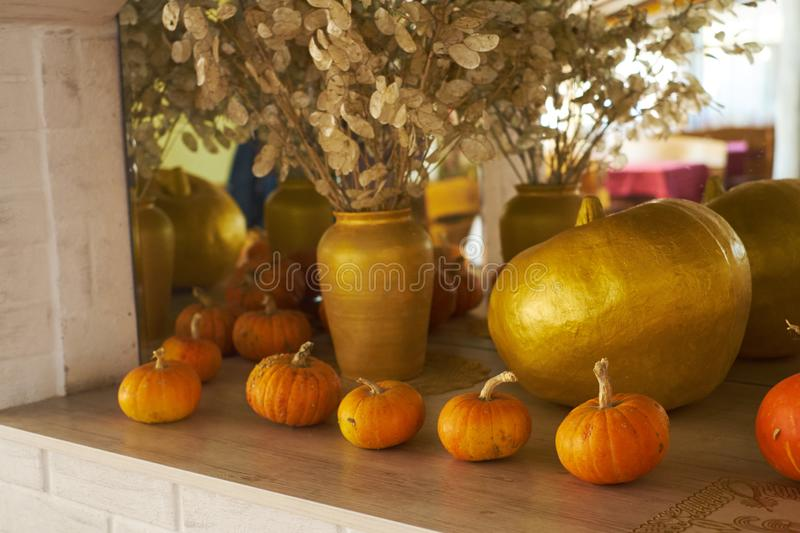 beautiful autumn composition with pumpkins. autumn cozy still life. pumpkins, autumn leaves and candles on wooden background. soft royalty free stock image