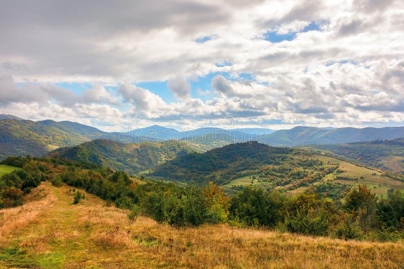 Beautiful autumn countryside with forested hills stock images
