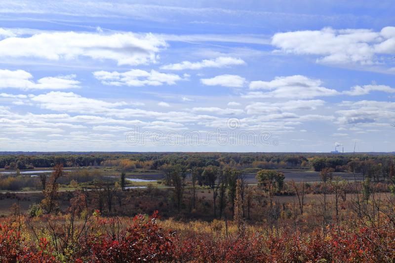 Beautiful autumn day in Minnesota with lovely cloud formations. Hill top wide angle shot of Minnesota Nature reserve in the late fall with stunning cloud stock photography