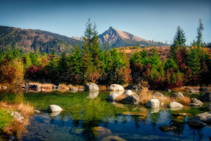 Beautiful autumn landscape with mountain peak and a lake, Krivan, Slovakia stock photos