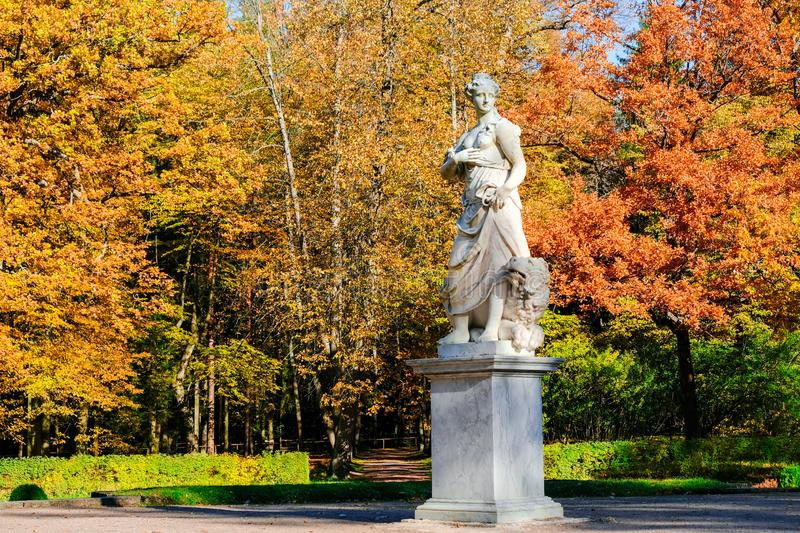 Beautiful autumn landscape in Pavlovsk park with the allegory sculpture Peace with a lion at his feet, Pavlovsk, Saint stock photos