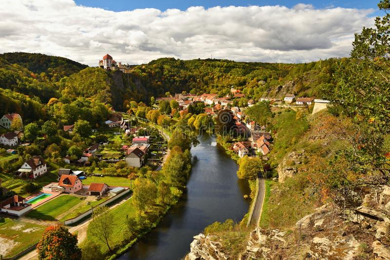 Beautiful autumn landscape with river, castle and blue sky with clouds and sun. Vranov nad Dyji Vranov above Thaya chateau, rive stock photography