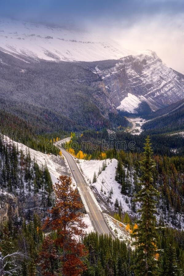Autumn winter mountains Alberta Kanada travel destination. Beautiful autumn landscape scene in mountain in background in National Parkwest Canada winding road royalty free stock images