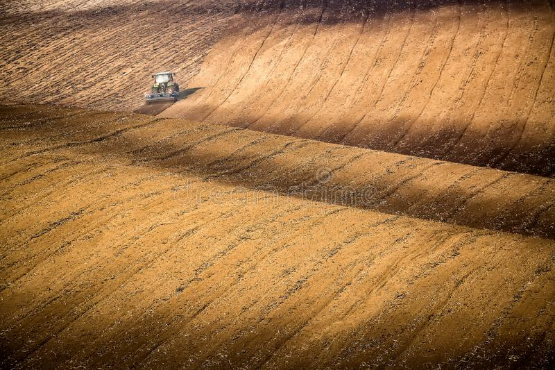 Beautiful autumn landscape with working tractor in south Moravia, Czech Republic. Agriculture concept. Czech TUscany. Moravian wav royalty free stock photos