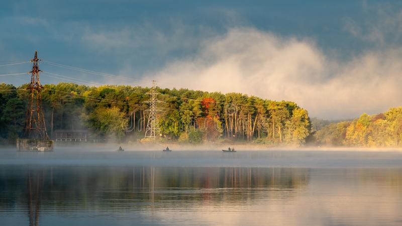 Beautiful autumn morning landscape of misty river. royalty free stock images