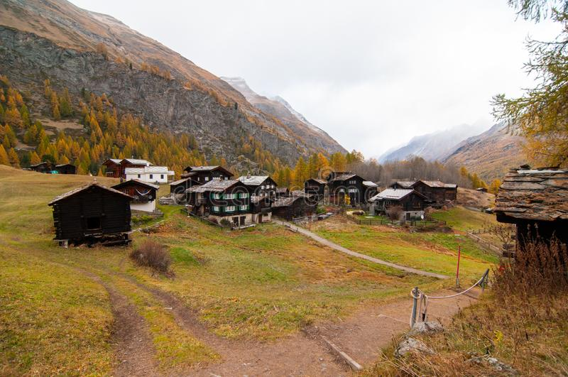 Beautiful autumn landscape with many old chalets in Zermatt area. Beautiful autumn mountain landscape in Swiss Alps, with many old chalets in Zermatt area royalty free stock photos