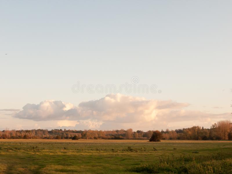 Beautiful autumn sky sunset clouds over field in country landscape. Essex; england; uk stock image