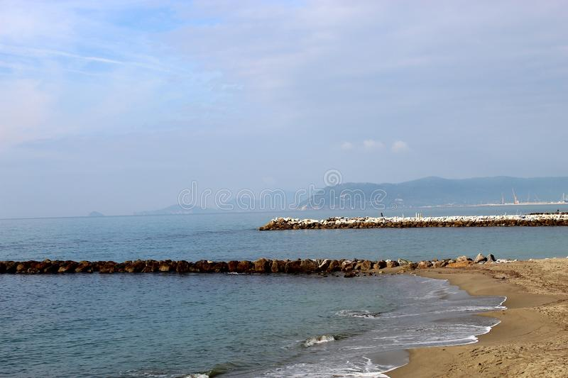 A beautiful autumn sunny day at the beach. This is the beach in Marina di Massa in Italy. It was a sunny day. The sea was calm. Beautiful blu color stock photos
