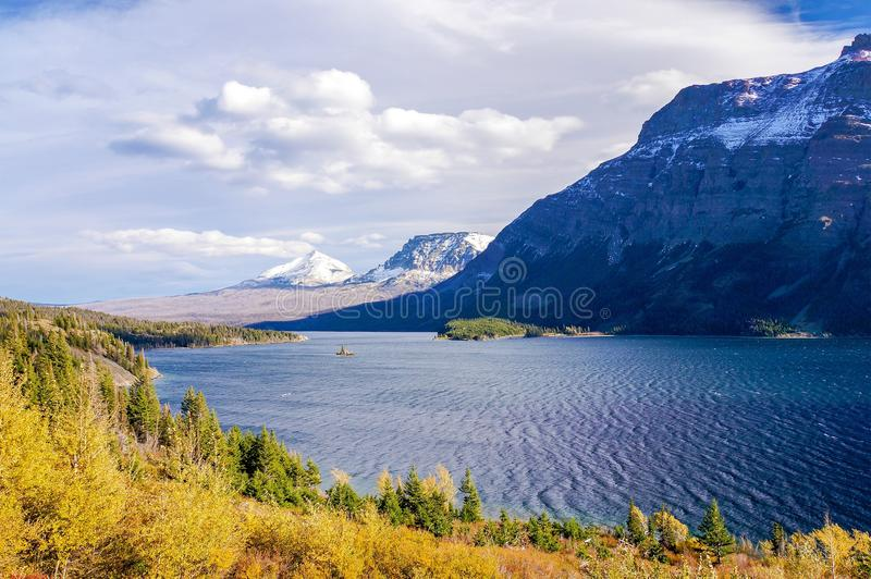 Beautiful autumn view of Going to the Sun Road in Glacier National Park, Montana, United States. Going-to-the-Sun Road is a scenic mountain road in the Rocky royalty free stock photos