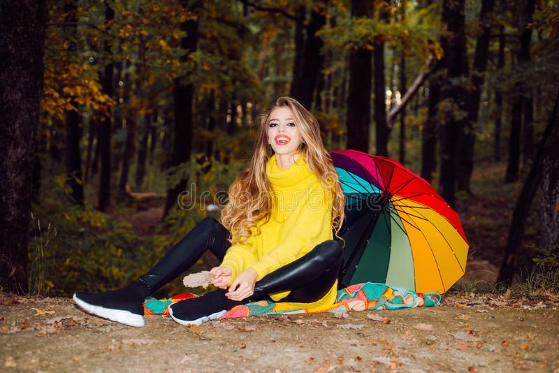 Beautiful Autumn Woman with Autumn Leaves on Fall Nature Background. Outdoor fashion photo of young beautiful lady stock photography