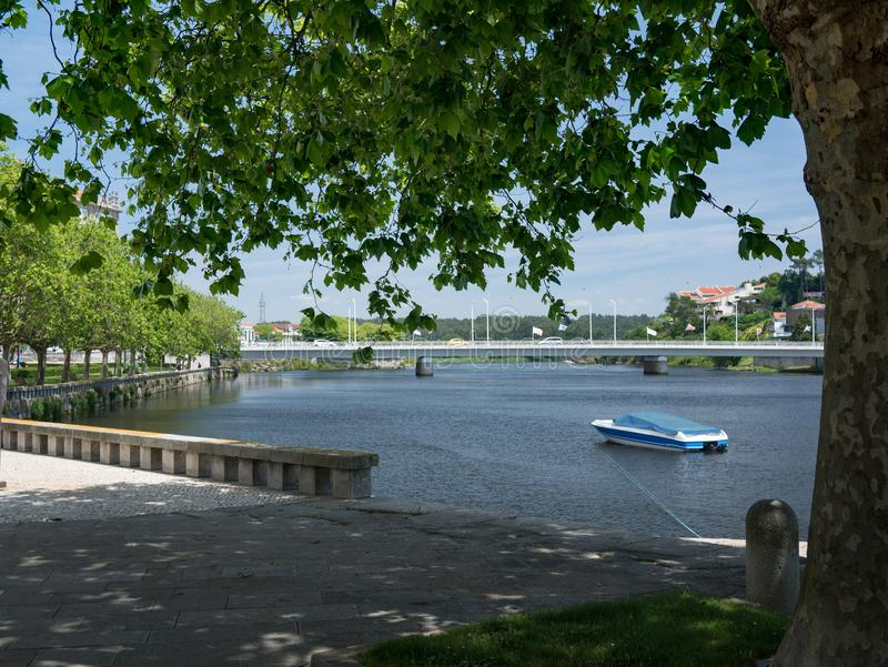 Beautiful Ave River under tree, Vila do Conde, Porto, Portugal. View under tree branches of the beautiful Ave River in Vila do Conde, Porto region, Portugal on a stock image